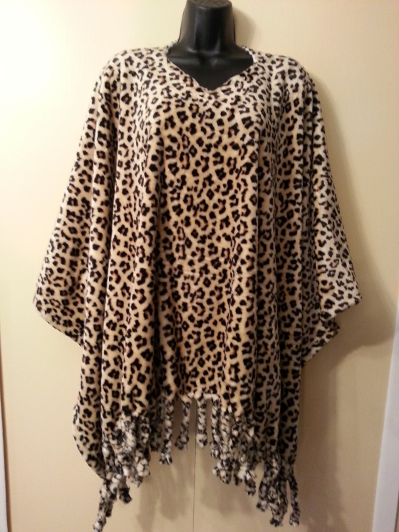 Soft warm and plush leopard poncho with fringes
